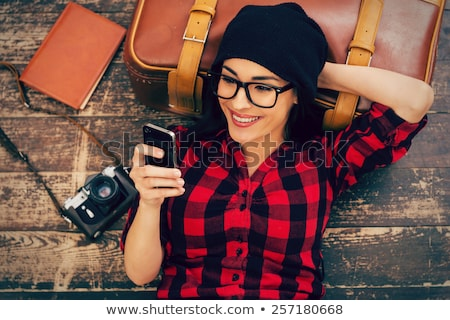 Caucasian traveler holding a mobile phone. Stock photo © RAStudio
