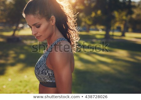 Close up shot of young sportswoman body. Fitness and healthy lad Stock photo © Nobilior