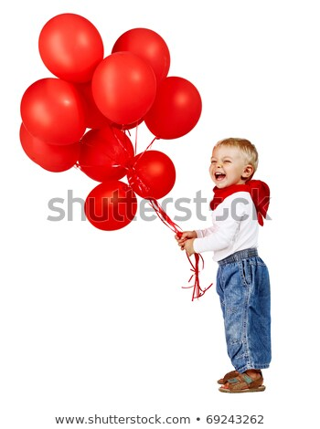 Boy holding bunch of red balloons Stock photo © IS2