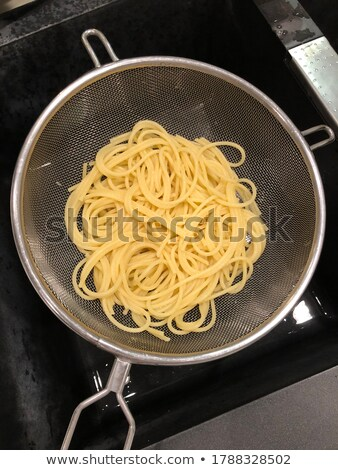 Fresh cooked spaghetti in stainless strainer Stock photo © Melnyk