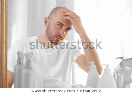 Bald man looking mirror at head baldness and hair loss Stock photo © ia_64