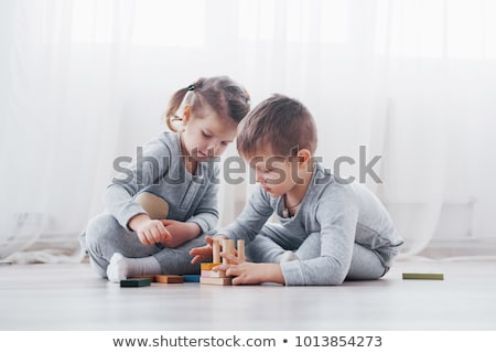 kid girl playing block toys at home stock photo © lopolo
