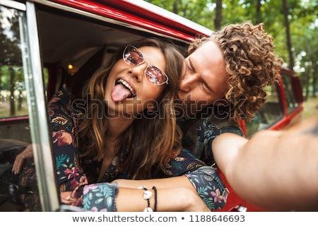 Fotó boldog hippi pár mosolyog mutat Stock fotó © deandrobot