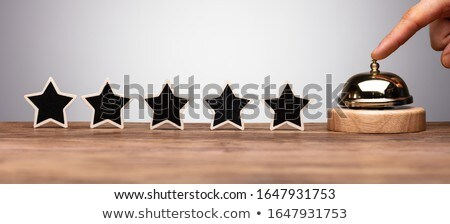 person ringing service bell near five star rating icon stock photo © andreypopov