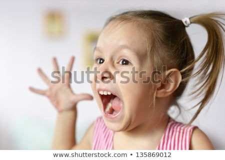 Portrait Of Angry Little Girl Screaming For Rage Stock photo © diego_cervo