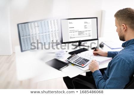 Ragioniere elettronica fattura fiscali bill laptop Foto d'archivio © AndreyPopov
