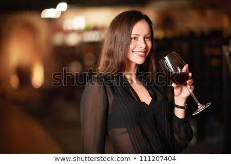 a woman drinking wine in a cellar Stock photo © photography33