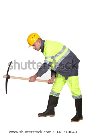 A male construction worker with a pickaxe. Stock photo © photography33
