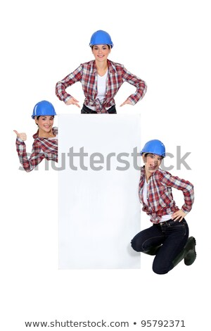 montage of happy handywoman with white sign for message stock photo © photography33