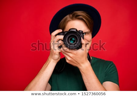 Tourist taking a photo with a DLSR camera Stock photo © photography33