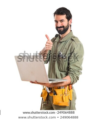 plumber with laptop and tools on white background stock photo © photography33