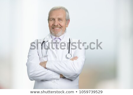 Handsome doctor smiling with arms crossed Stock photo © jarenwicklund