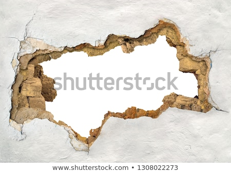 Texture of the old wall with holes Stock photo © stockyimages