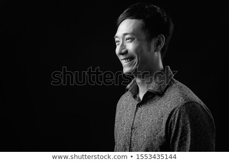 Young corporate guy, studio shot. Stock photo © stockyimages