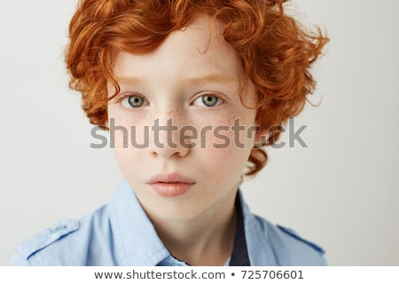 young red haired boy looking confident and happy Stock photo © meinzahn