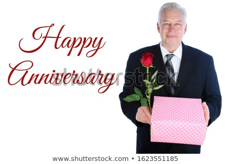 Portrait of a businessman holding a red 'Love' text Stock photo © bmonteny