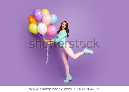 smiling woman holding balloon stock photo © deandrobot