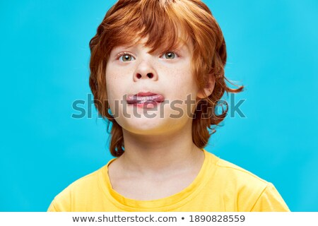 A boy biting his tongue Stock photo © bluering