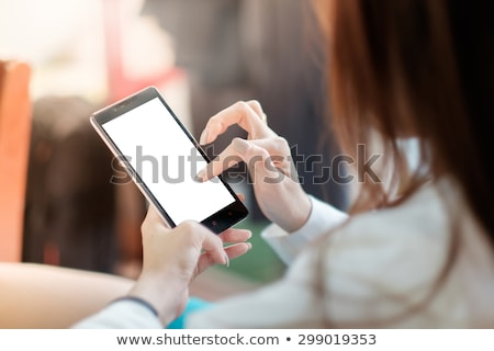 woman holding blank business card and mobile phone stock photo © stevanovicigor