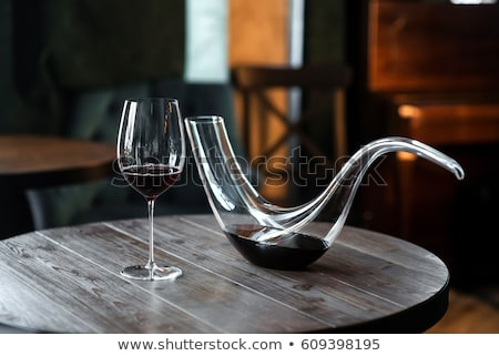 Decanter with wine and grapes in wineglass Stock photo © brulove