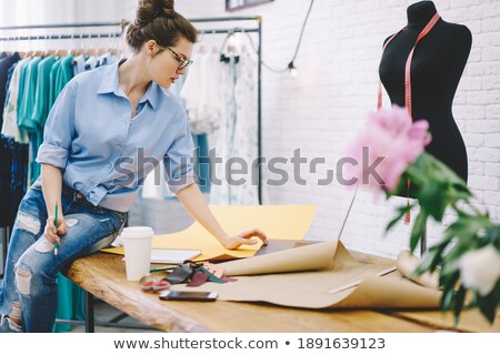female using sewing patterns in atelier stock photo © dash