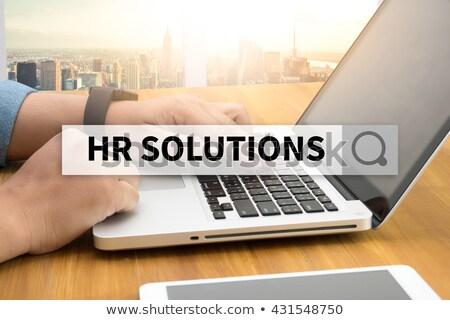 HR Solutions on Office Folder. Blurred Image. Stock photo © tashatuvango