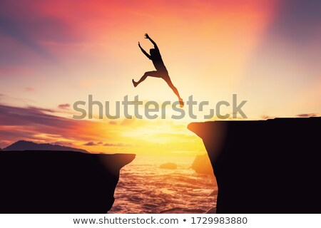Man jumping from rock to rock Stock photo © IS2