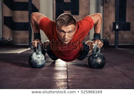 Férfi padló testmozgás bogrács harang energia Stock fotó © IS2