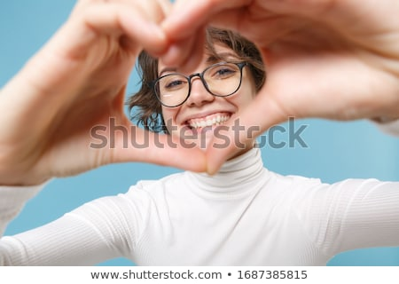 Young brunette girl with glasses in the form of a heart. The hairs are gathered in a bun. The girl s Stock photo © Traimak