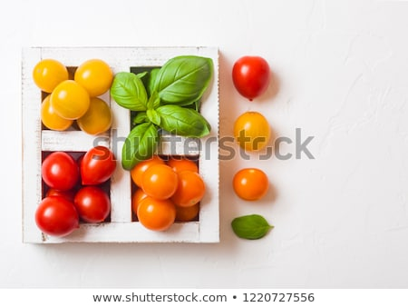 Organic Mini Tomatoes with basil and pepper in wooden box on stone kitchen background. San Marzano,  Stock photo © DenisMArt