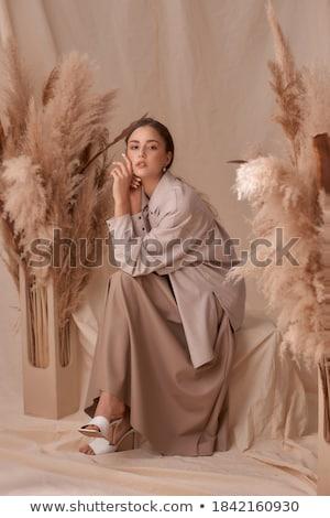 молодые брюнетка бежевый куртка стены шкаф Сток-фото © acidgrey