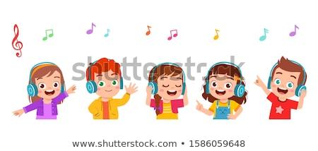 Happy little boy listening music Stock photo © Anna_Om