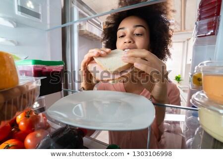 Femme sandwich plaque réfrigérateur faim Photo stock © AndreyPopov