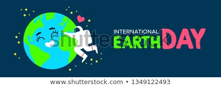 Earth Day banner of astronaut hugging planet Stock photo © cienpies