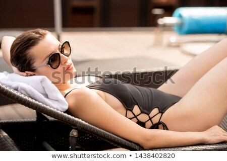 молодые женщину черный шезлонг Сток-фото © pressmaster