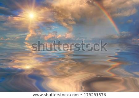 бурный закат воды облака гор Сток-фото © lovleah