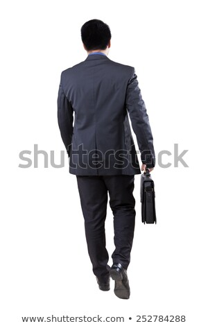 business man walking and carrying suitcase stock photo © feedough