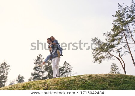 Strong man and his attractive blonde wife Stock photo © konradbak