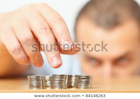 бизнесмен · монетами · молодые · ответственный · бизнеса · черный - Сток-фото © andreypopov