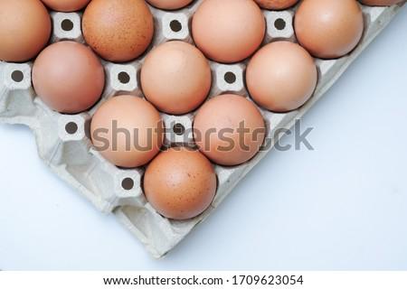 white and brown eggs in the box Stock photo © ozaiachin