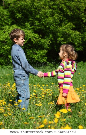 boy and  girl handshaking among blossoming dandelions Stock photo © Paha_L