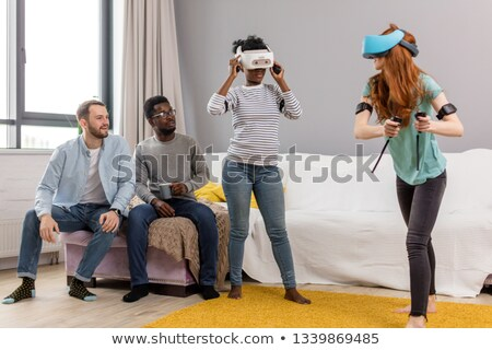 two joyful african american young men using vr device stock photo © deandrobot