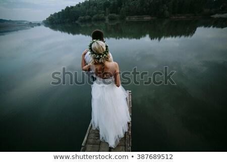 wedding couple on the old wooden pier stock photo © tekso