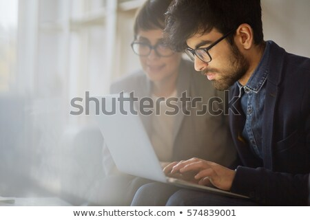 A Middle Eastern Business Woman Sitting With A Laptop Stock photo © Pressmaster