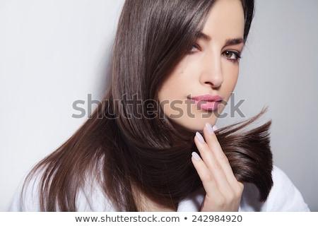 beautiful woman holding her hair on white stock photo © alexandrenunes