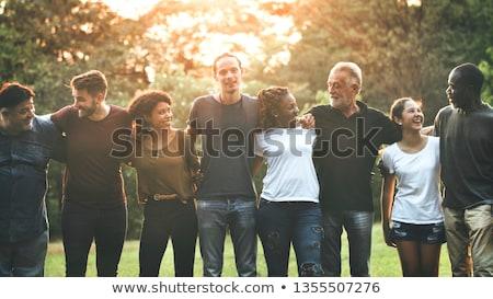 Różnorodny znajomych parku grupy szczęśliwy Zdjęcia stock © Kzenon