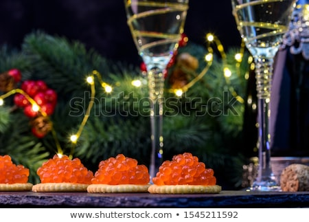 Stock photo: Two bowls with red salmon caviar
