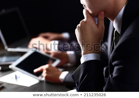 Young serious well-dressed businesswoman concentrating Stock photo © pressmaster