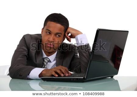 Young salesman sat at desk Stock photo © photography33