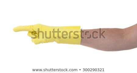 Hand in an cleaning glove making a directional sign Stock photo © michaklootwijk
